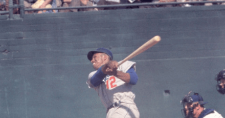 Tommy Davis, trying to break up a double play, dislocates and breaks his ankle sliding into second base