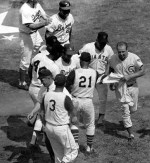 "St. Louis hosts a hot midsummer All-Star classic. Maury Wills' 10th-inning single scores Tim McCarver, as the National League wins, 2 - 1, in 105-degree heat. Brooks Robinson's stellar game (3 hits, eight chances) earns him the game MVP award. Asked about the new ballpark, Casey Stengel remarks, ""it holds the heat well."" On-field temperature is 113 degrees."