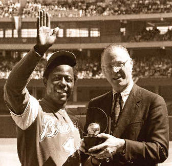 Commissioner Bowie Kuhn orders the Atlanta Braves to play Hank Aaron in at least two of the team's season-opening three games on the road
