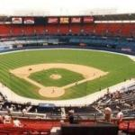 34 couples are married at home plate  at Atlanta's Fulton County Stadium