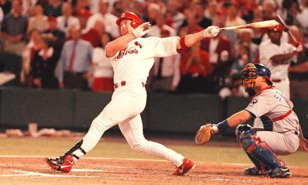 Mark McGwire of the St. Louis Cardinals breaks what is arguably the game's most prestigious single-season record: Roger Maris' mark of 61 home runs