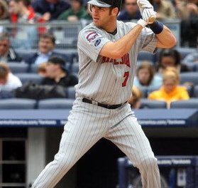 Joe Mauer of the Minnesota Twins becomes the first catcher to win the American League batting title