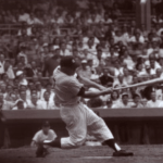 Mickey Mantle blasts the first home run of his career in an 8-3 victory