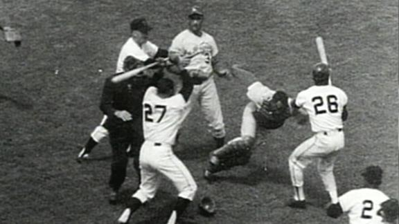 San Francisco Giants ace Juan Marichal hits Los Angeles Dodgers catcher John Roseboro over the head with a bat.
