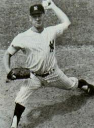 With only one Cy Young Award given for the two leagues Whitey Ford,  wins the honor ahead of Warren Spahn