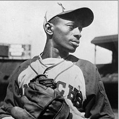 Satchel Paige strikes out Josh Gibson on three pitches with the bases loaded