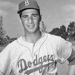 Brooklyn Dodgers option left-handed pitcher Tommy Lasorda to the Montreal Royals to make room for Sandy Koufax