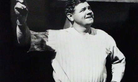 Babe Ruth of the Providence Grays hits his first professional home run and also pitches a one-hitter