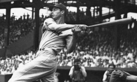 Joe DiMaggio of the New York Yankees hits three 400-foot home runs against the Washington Senators