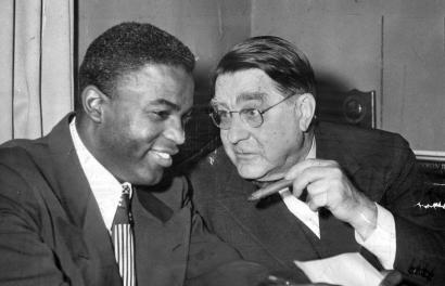 A moment in American history takes place in Brooklyn as Branch Rickey meets with Jackie Robinson