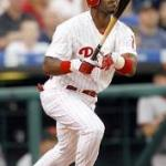 Jimmy Rollins hits a double on opening day to extend his hitting streak to 37
