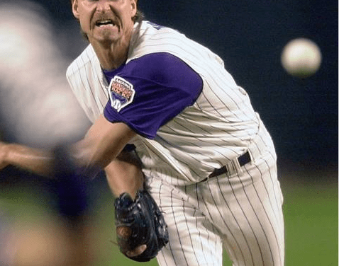 Diamondbacks flamethrower Randy Johnson strikes out 20 Reds in Arizona's 4 – 3 win over Cincinnati in 11 innings