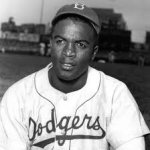 Jackie Robinson collects first hit