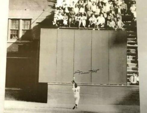 Willie Mays of the New York Giants makes an incredible over-the-shoulder catch against Cleveland's Vic Wertz in Game One of the World Series