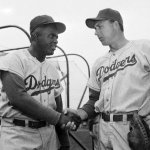 60th anniversary of Jackie Robinson's debut, the entire Dodger team wears uniform #42 in his honor
