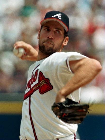 John Smoltzbecomes the 16th major league pitcher tostrike out3,000 batters