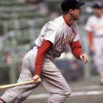 Stan Musial of the St. Louis Cardinals collects his 3,000th hit