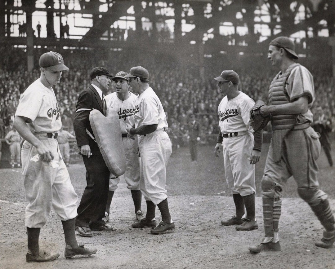 7 May 1941: Dolph Camilli and manager Leo Durocher argue a close play at the plate. That's Pee Wee Reese on the left, Paul Waner on the right, and Cardinals' catcher Walker Cooper listening in.