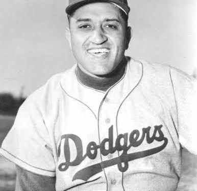 Don Newcombe becomes the first black to win twenty games in a season. In a must win for the Dodgers, the right-hander bests Robin Roberts, also a 20-game-winner, when he blanks the Phillies at Shibe Park, 5-0.