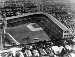 (ca. 1940)[^](http://digitallibrary.usc.edu/cdm/compoundobject/collection/p15799coll65/id/1322/rec/63) – Aerial view showing  Wrigley Field at pre-game ceremony.  An American  flag being  supported by four lines of people can be seen below the  diamond. A group of  people stand in rows to the left of the flag while  the lower levels of the  stadium are visibly full.