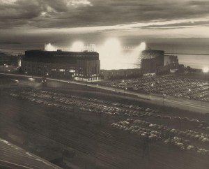 Cleveland Municipal Stadium, June 30, 1950 - A stunning photo of this enormous ballpark taken during a night game between the Detroit Tigers and Cleveland Indians. 50,882 were on hand to see the Tribe in a 11-3 romp with slugger Luke Easter hitting two home runs and driving in four runs.  The Tigers ace Hal Newhouser only lasted one inning giving up five earned runs on six hits. After winning 136 games the previous six seasons, Newhouser would struggle in 1950 going 15-13 and a hefty 4.34 ERA.  Mike Garcia took the mound for Cleveland and despite struggling some he did get the complete game win to improve his record to 6-4 on the season. The California native gave up just five hits but walked seven Tigers batters