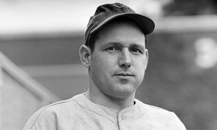 Bill Nicholson of the Chicago Cubs makes his bid to become the first player in Wrigley Field's 34 years of existence to reach its distant right centerfield scoreboard
