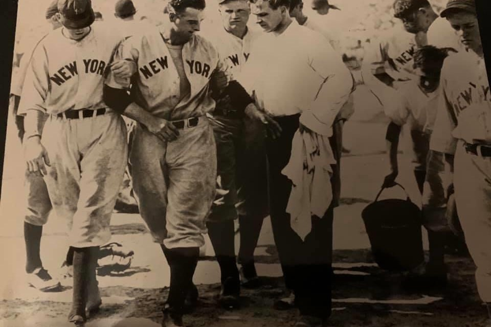 Lou Gehrig, being led from the field after being beaned and knocked unconscious during a game at Norfolk Virginia. July 3, 1934.