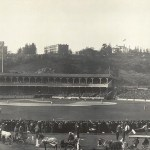 Just two and a half months after a fire destroyed the oldPolo Grounds, the new grounds open for business. The oldbleachers, seating 10,000, were untouched, but the new double-deckergrandstandseats another 16,000. Only 6,000 fans show up for the inauguration asChristy Mathewsonshuts out theRustlers, 3 - 0, on nine hits. On the front end of adouble steal, Mathewson swipes home in the 4th inning. While guests at theHighlanders'Hilltop Park, the Giants won 21 of 29 games.