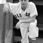 August 9, 1949 - Dom DiMaggio's 34-game hitting streak is on the line against Vic Raschi and the Yankees. Hitless in his first four at bats, Dom hits a sinking line drive in the 8th that his brother Joe catches at his shoetops. The Red Sox win, 6 - 3, to move 5 1/2 games behind the Yankees. Dom had started his streak after going hitless against Raschi.
