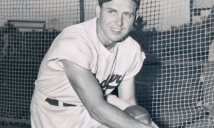Gil Hodges straps on the catcher's gear