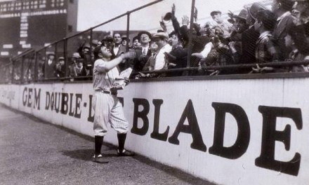 Babe Ruth throws his Babe Ruth candy bars to the fans sitting in the outfield in Yankee Stadium before a game in 1922.