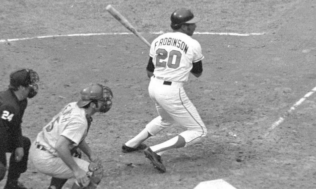 Frank Robinson homers in Game 5 of the 1970 World Series. Bench looks on.