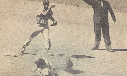 Hank Aaron plays second base and turns two