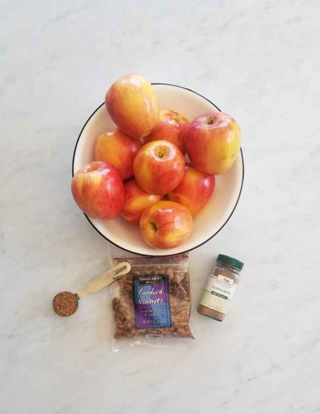 Ingredients for baked apples set on marble table.