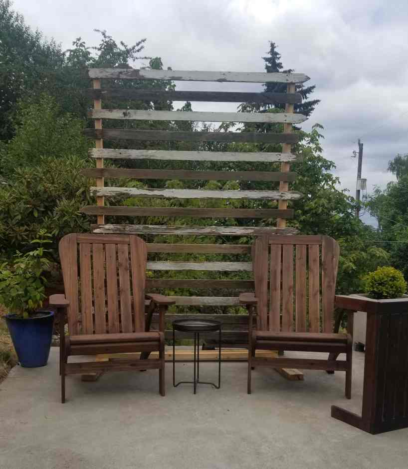 Small patio furniture placement with DIY privacy screen.