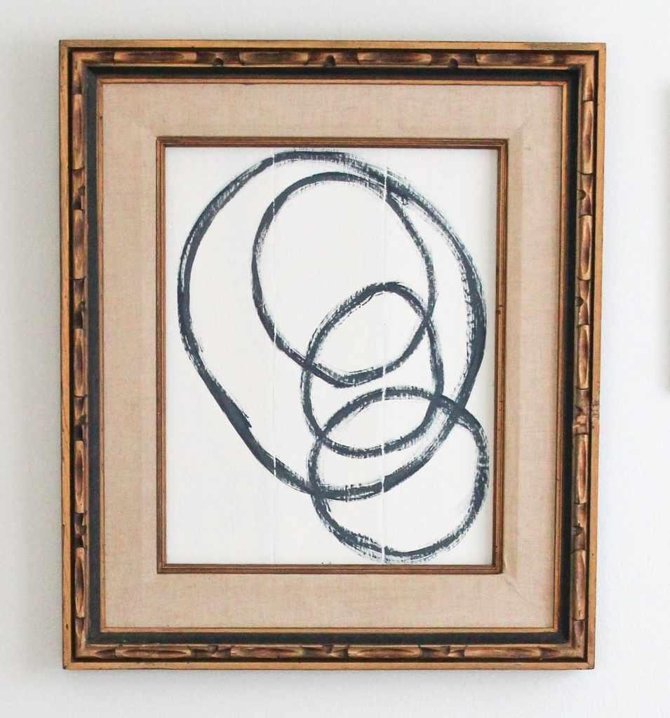 DIY abstract art painted on cardboard in vintage frame.
