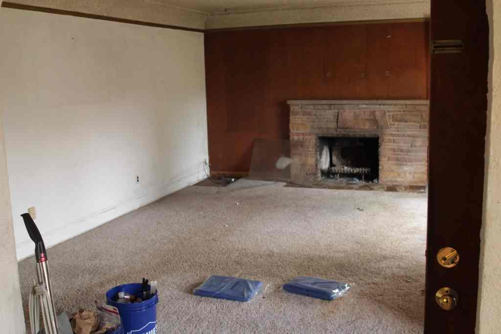 Living room with fireplace before a remodel project starts.