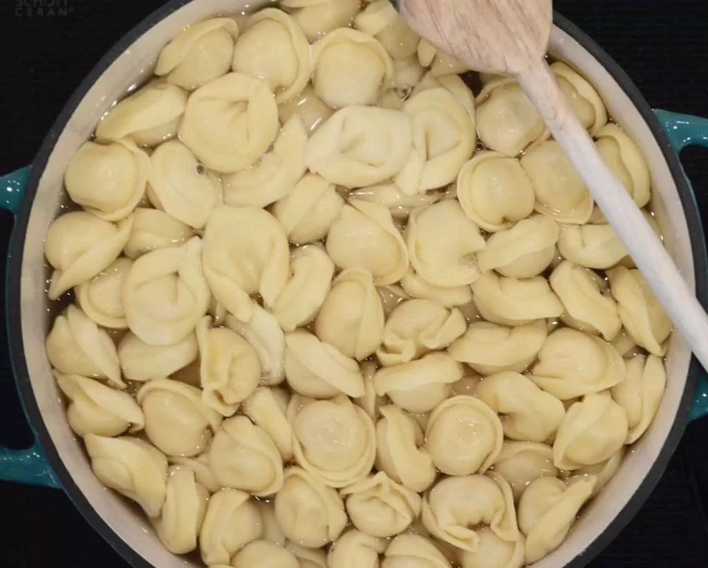 tortellini boiling in a pot of water