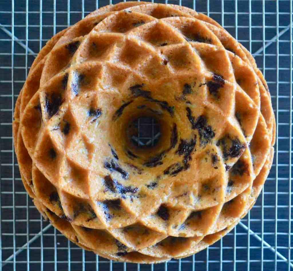 blueberry lemon bundt cake baked in a jubilee cake pan cooling on a wire rack
