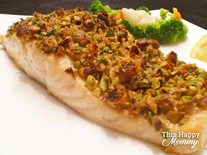 My family loves this quick and easy salmon dinner!Panko Pistachio Crusted Salmon is a flakysalmon fillet covered with a maple-sweetened, pistachio crust. Yum! | healthy fish recipes | healthy oven baked fish | easy baked salmon | healthy crispy baked fish | quick and easy baked fish | clean eating salmon recipes | #healthyrecipes #salmon #fish #dinner #cleaneating | thishappymommy.com