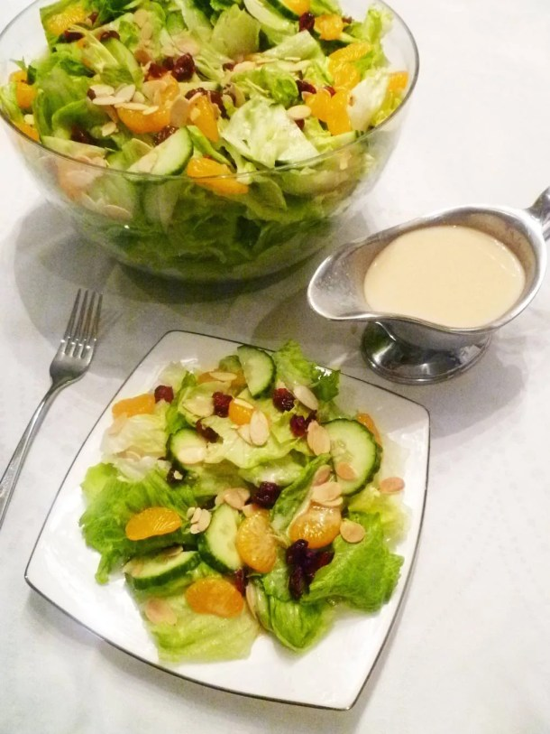 Creamy Orange Salad -- Crisp lettuce with sweet and creamy orange dressing, mandarin orange slices and roasted almonds. | thishappymommy.com