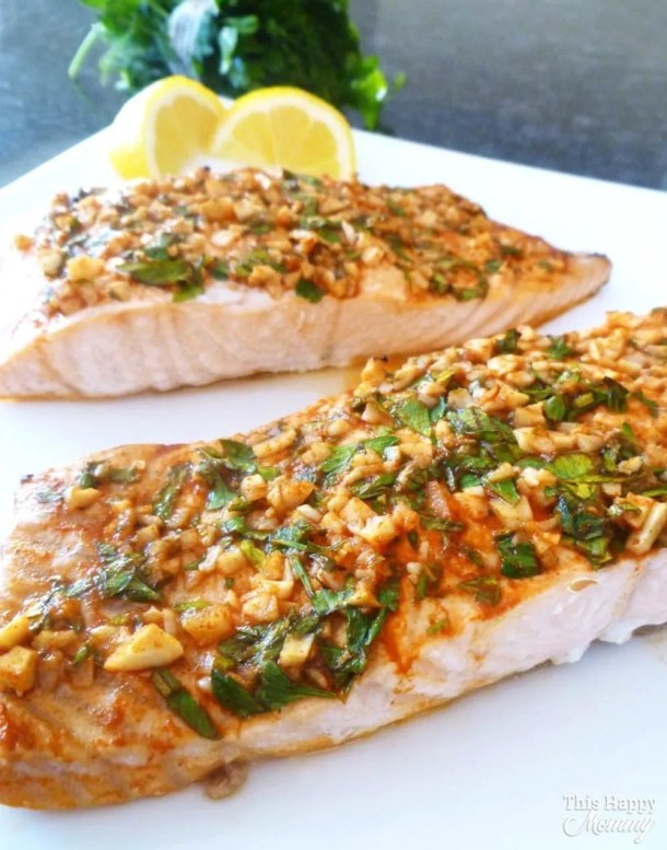 Serve up a quick and easy salmon dinner that is full of flavour! Lemon Herb Crusted Salmon is covered with lemon, garlic, and fresh parsley. This is one tasty baked fish dish. healthy oven baked salmon | skinny salmon dinner | #fish #salmon #dinner #recipe #easydinner | thishappymommy.com