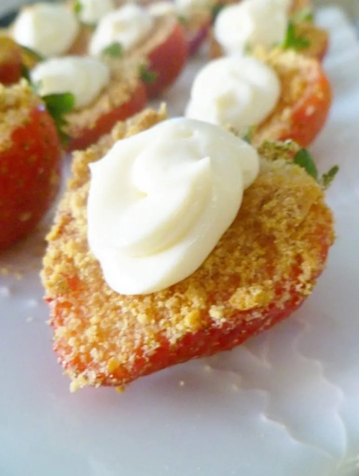 Strawberry Cheesecake Bites - Strawberry bites covered with a graham cracker crust and a swirl of creamy cheesecake.   thishappymommy.com
