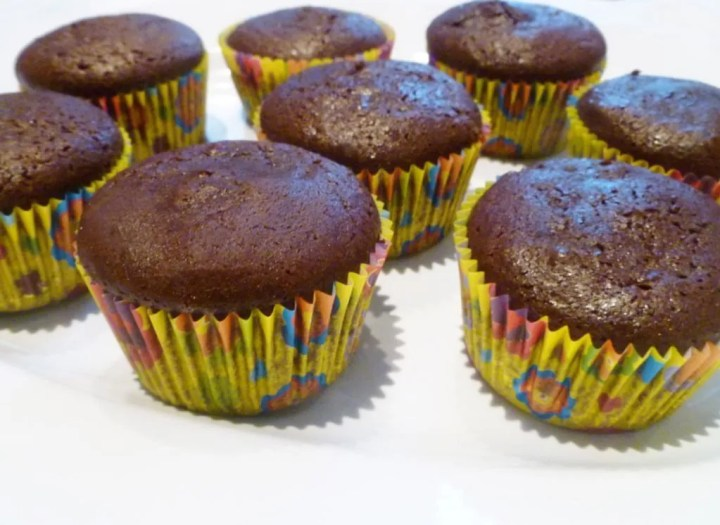 Double Chocolate Cupcakes -- Chocolate lovers, this is the cupcake for you! With light and fluffy chocolate batter and milk chocolate frosting, these cupcakes are yummy.   thishappymommy.com