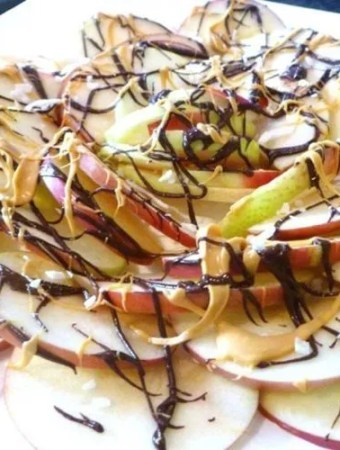 Thinly sliced apples covered with chocolate, butterscotch, and coconut flakes.Chocolate Apple Nachos are a wonderful way to enjoy fresh apples. With only four ingredients, this simple, kid-friendly treat is perfect anytime.