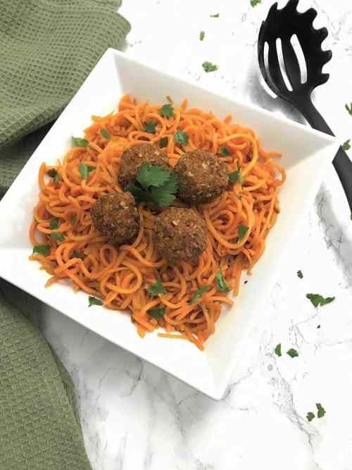 sweet potato noodles with lentil balls garnished with fresh cilantro