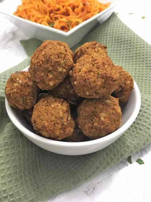 vegan lentil meatballs with sweet potatoes in background