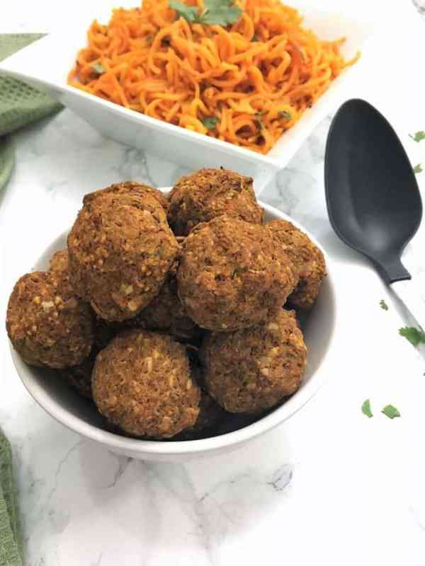 vegan lentil meatballs in a bowl with sweet potato noodles in background