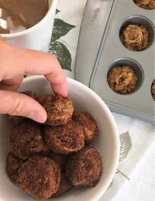 hand reaching for pumpkin spice donut holes