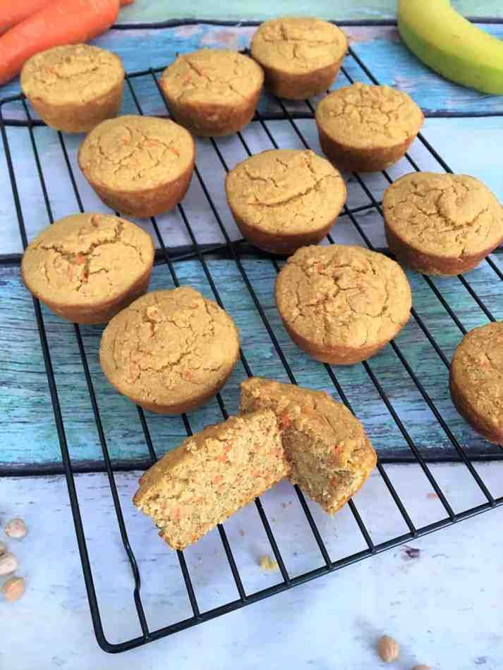 carrot cake muffins on cooling rack with one cut in half